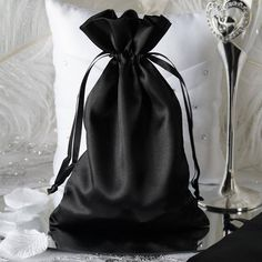 6x9 Black Satin Bags - 12/pk | Have a rare color theme? These glimmering satin bags will solve your problem. With over 14 colors & 2 styles & sizes to choose from, you will surely find your perfect favor holder. Great for packaging jewelry as well. Each order contains 1 dozen bags. Bags are flatback.