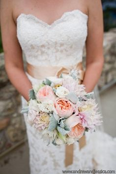 Bridal bouquet of dahlias, garden roses and dusty miller