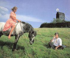England in Peasmarsh, Rye, 1986. Linda McCartney Riding her Appaloosa Horse & Paul McCartney sitting & smoking his Marihuana Joint