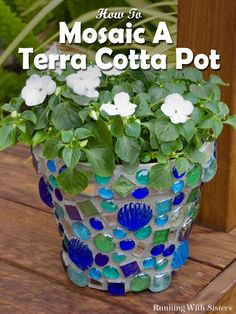 DIY Mosaic Pot - Learn how easy it is to mosaic a terra cotta pot with this craft tutorial! We'll show what tiles to use, how to glue the tiles to the pot, how to mix and grout your mosaic, and how to seal your mosaic for the garden. Includes step by step instructions and photos. Great garden craft and easy mosaic project for beginners!