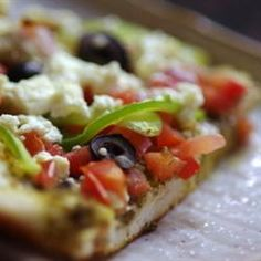 Pesto Pizza - Top a prepared pizza crust with pesto, your favorite veggies and feta cheese and you've got a great, quick and easy meal.