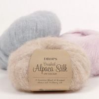 A luxurious yarn in an exclusive mix of brushed, superfine alpaca and subtle shiny silk! Besides being super soft, DROPS Brushed Alpaca Silk has a. Knitting Needles, Knitting Yarn, Free Knitting, Knitting Patterns, Crochet Patterns, Crochet Ideas, Drops Alpaca, Baby Alpaca, Rugby Sport
