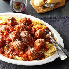 Slow Cooker Spaghetti & Meatballs Recipe -I've been cooking 50 years and this dish is still one that guests ask for frequently. My No. 1 standby recipe also makes amazing hero sandwiches, and the sauce works for any pasta. —Jane McMillan, Dania Beach, Florida