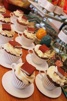 Book cupcakes in teacups.