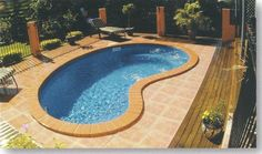 stone color and border around perimeter of pool and juxtaposition to wood deck...material transition (steps)