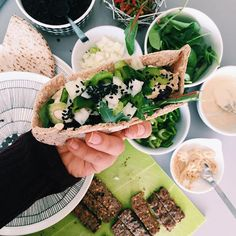 Black rice, lentils, organic pacific seitan (oil free), lettuce, sweet onions, low fat tahini and hummus ohhhh and black sesame seeds  (snapchat: essena.oneill)