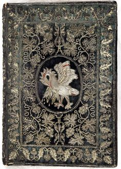 Pelican piercing breast -on front board of embroidered binding of Holy Bible & Book of Common Prayer (Cambridge,1629)