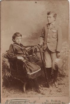 Cabinet photo of 2 victorian children with a Cricket Bat taken in Edinburgh, Scotland around 1890s by the K. Ramsay Russell studio located at 9 Morningside Road, St. Bride's.