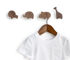 Set of 4 safari animal wall hooks - lion, elephant, hippo and giraffe. Animals not sold separately.  These hooks are perfect for clothes hangers, small