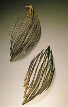 "Earrings, 2001  Reiko Ishiyama | sterling silver and 18k gold (bimetal), oxidized   each 3/4 x 1 1/4 x 2 3/4 ""  Photo: Ralph Gabriner"
