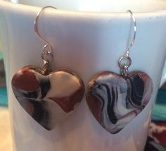DIY earrings. Polymer clay hearts, with sterling silver ear wires. Colors: brown, black, white, silver. Sanded to a smooth finish.