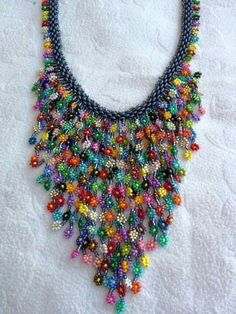 Seed bead necklace with Daisy chain dangles Seed bead jewelry no tute - just an interesting piece where the fringe dangles are made with daisy chain flowers. ~ Seed Bead Tutorials Discovred by : Bead Jewellery, Seed Bead Jewelry, Beaded Jewelry, Handmade Jewelry, Beaded Bracelets, Jewelry Rings, Stretch Bracelets, Handmade Wire, Seed Beads