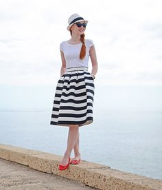 black and white stripe midi skirt with white t-shirt and red shoes