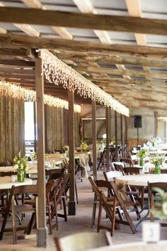Twinkling icicle lights are a beautiful idea for a rustic reception {Photo by Retrospect Images via Project Wedding}