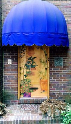 Take one ordinary wood front door, add a beautiful painting plus a brightly-colored umbrella awning, and you've got a front entry everyone will turn their eyes toward!  We've got lots of beautiful front doors that can be the centerpiece of your entry if you live in the Minneapolis MN area.  http://www.replacementwindowsmpls.com