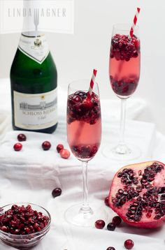 These gorgeous Cranberry Pom Champagne Sparklers are absolutely stunning, super easy to make, and perfect for the holidays!