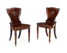 A pair of George IV mahogany hall chairs (2)