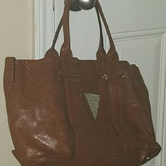 Purse Large Brown Guess shoulder bag. Barely carried, but the inside does needs a little cleaning.. ???? Guess Bags Shoulder Bags
