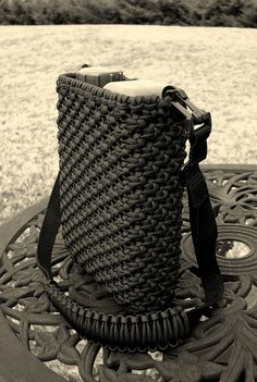 Paracord canteen cover, 1L Flat Pack Canteen from County Comm. Mostly done with basic square knotting/macrame knot work, with finishing up the bottom causing quite a bit of consternation, settling with some sewing to end it. 200+ feet of paracord use paracord