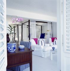 Blue and white bedroom with pink accents - Round Hill Jamaica