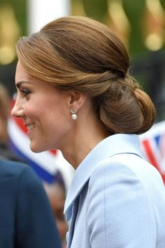 She chose an intricate up-do, displaying pearl drop earrings, for an official visit to the Netherlands.