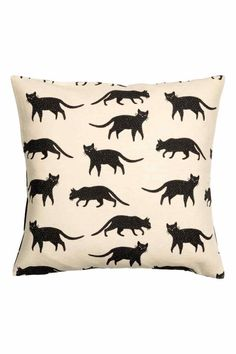 This cat covered cushion. | 19 Impossibly Cute Products You Need If You Love Black Cats