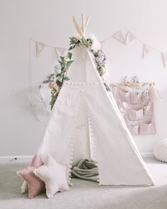 Blush & Grey Flower Garland fits perfectly on this toddler Girl Bedroom. How adorable is that teepee?! Play tents are such a fun idea. Beautiful little girl nursery decorations. #babygirl #blushbedroom