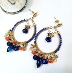 Blue Hoop Earring Gold Chandelier Hoop Earring Blue Gemstone Chandelier Hoop Earring Colorful Statement Blue Lapis Beaded Boho Chandelier Large 14kt gold filled hoop earrings are wire wrapped with multi color gemstones of cobalt blue, orange and gold to create these glamorous,