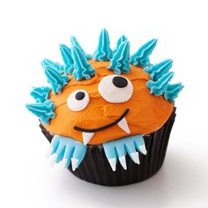 Orange-and-Blue Monster Cupcake...so many fun cupcake designs from bhg.com. Check them out.
