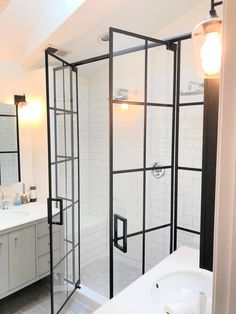Glass shower enclosures by Ultimate Glass Art, Inc in Chicago. Ultimate Glass specializes in custom glass shower doors with Grid Designs using matte black shower hardware. Custom design your next shower door and enclosure with Ultimate Glass Art.