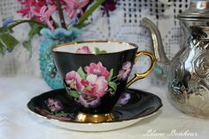 Windsor England: Tea cup and saucer black with pink and