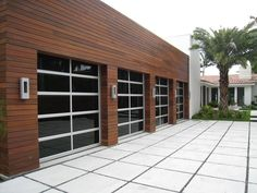 This is a contemporary glass with aluminum frame garage door by Radford Overhead Doors Inc. of San Diego California. Custom Garage Doors, Glass Garage Door, Custom Garages, Contemporary Garage Doors, Modern Garage Doors, Door Design, House Design, Garage House, Car Garage