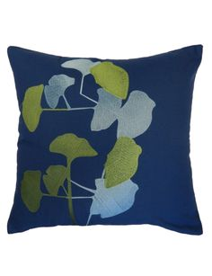 The medley of foliage silhouettes enhance this bold cushion.