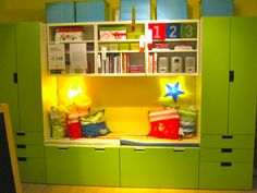 stuva system - LOVE the little reading nook area. Which can easily double as a desk by removing the pillows and pulling out the toy boxes