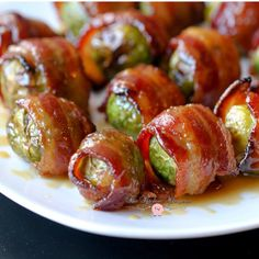 The absolute best Brussels Sprouts recipe you'll ever eat! These Candied Bacon Wrapped Brussels Sprouts with Maple Dijon Glaze are always a crowd favorite! Bacon Wrapped Brussel Sprouts, Brussels Sprouts, Brussel Sprout Salad, Vegetable Dishes, Vegetable Recipes, Candied Bacon, Cooking Recipes, Healthy Recipes, Game Recipes