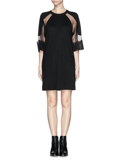 Feminine grace and poise come in the form of this laced sleeve dress from See by Chloé. Imbuing a basic dress with a sensual edge, this lightly dotted piece is appealing with its flattering peek-a-boo effect.