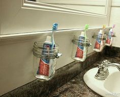 Mason Jar Bathroom Storage This is BRILLIANT. I hate when toothbrushes touch and that you can never put the holder in the dishwasher. Old toothpaste gunk and bacteria? ICK! This solves all of those issues. And it's good when you have a lot of kids.