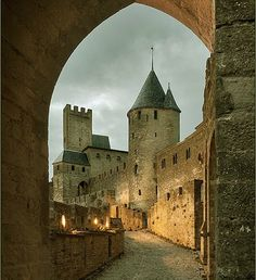 """Aude Barbican, Château Comtal (Count's Castle), Cité of Carcassonne, Aude department, Languedoc, France... www.catharcountry.info (Places still available for the 2018 tours) ... The Cité of Carcassonne is the largest city in Europe with its medieval city walls still intact. Although the outer curtain wall of the cité is French, and the whole site has been substantially restored, the Château Comtal has a strong claim to be called a """"Cathar Castle""""."""