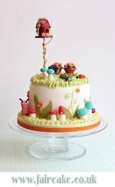 Bird House Cake --- Again, wish there were gnomes among those cute little mushrooms to hang out with the snails, ladybugs, and caterpillars. by kim