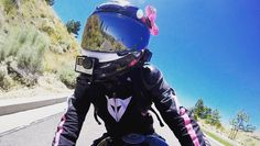 """LuckyYogi helmet bow in """"unpredictable"""" hot pink with silver metal spikes being repped by @bilibeanmoto #handmade #helmetbow #helmetbows #luckyyogihelmetbows #girlswhoride #bikerchick"""