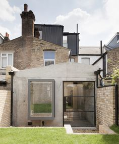 Having the entry to garden space include a door and window signifies this is a main entrance, and that the garden is a true extension of the structure of the home.