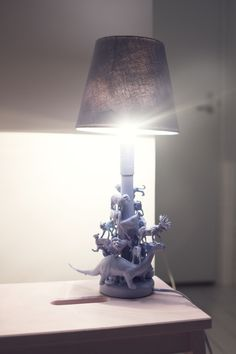 Boring lamp + plastic animal toys + some color to paint with + some glue = totally amazing lamp!