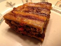 Pastelon (Puerto Rican lasagna made with plantains) Slightly sweet and a little spicy, this dish rocks! Ugh my dad makes the best pastelon! Puerto Rican Lasagna, Puerto Rican Dishes, Puerto Rican Cuisine, Puerto Rican Recipes, Cuban Recipes, Real Food Recipes, Cooking Recipes, Yummy Food, Spanish Recipes