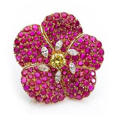 A fancy colored diamond, diamond and ruby brooch, Cartier