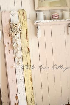 Salvaged fence boards, painted with chalk paint and painted silk flowers = a shabby treasure!!!  Basic DIY.