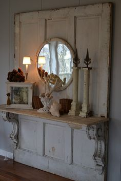 Repurposed door with shelf and corbels. Add hooks and vintage doorknobs to make it a hall tree.