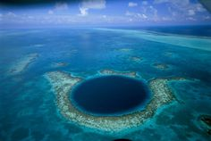 The blue hole in the coral reef lighthouse leaf of Belize