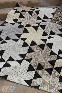 Jaybird Quilts, Ballerina. I like the way the triangles dance in this quilt. I would make the rest one color and the triangles scrappy.