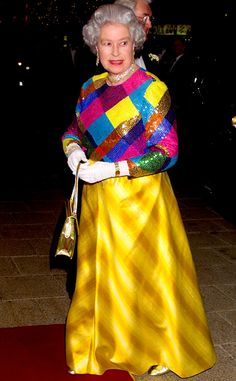1999 from Queen Elizabeth II's Royal Style Through the Years  Her Royal Highness attended the Royal Variety Performance in Birmingham, England, sporting an eye-catching multihued gown.