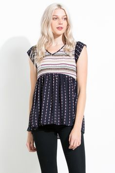 The mixed prints and cap sleeves on this babydoll top adds a cute bohemian vibe to any outfit!